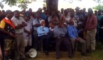 Governor Sir Arnold Amet and Provincial Administrator Joseph Dorpar listen to the crowd
